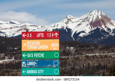 Colorful sign pointing to a variety of ski runs at Purgatory ski resort in Durango, Colorado