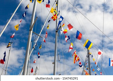 Colorful signal flags on a sailing boat in sunshine