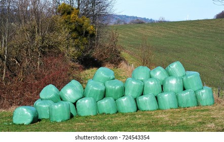 Colorful Silage Bale Wrap in Agricultural Pasture