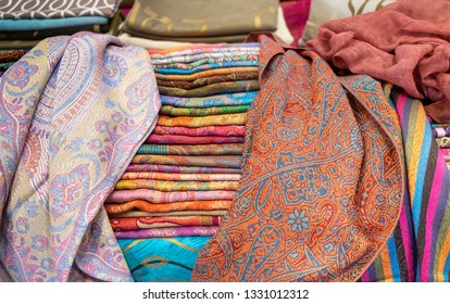 Colorful silk pashminas scarves or shawls for sale at farmers market
