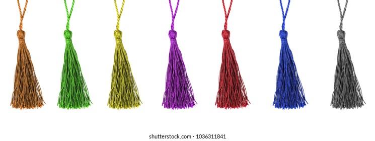 Colorful silk tassels on white background.