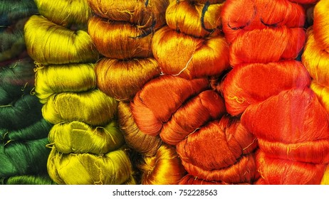 Colorful silk thread. Raw materials for asian silk weaving. Repetitive and pattern background.