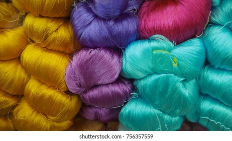 Colorful silk thread. Raw materials for asian weaving. Repetitive and pattern background.