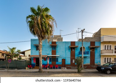 Colorful and simple buildings under exotic palm tree in Sal island, Cabo Verde, Cape Verde