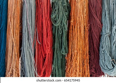 Colorful skeins of silk thread to create traditional Turkish carpet on a loom.