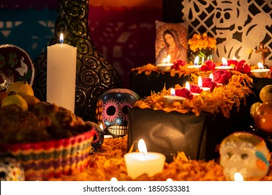 """Colorful skull on colorful traditional Day of the Dead """"ofrenda"""""""