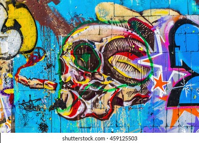 Colorful skull. Street art graffiti. Closeup painted wall of the city.
