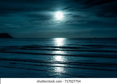 Colorful sky with cloud and bright full moon over seascape in the evening. Serenity nature background, outdoor at nighttime. The moon taken with my own camera.