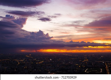 Colorful of sky and cloud in sunset,and twilight,with cityscape in the evening