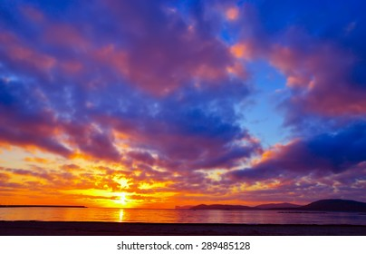 colorful sky over Alghero at sunset, Sardinia