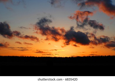 colorful sky at sunset with foreground silhouette