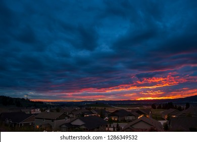 A colorful sky at sunset looking out over an American subdivision in the Pacific Northwest.