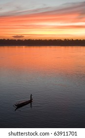Colorful sky at sunset over Mekong river, fisherman boat