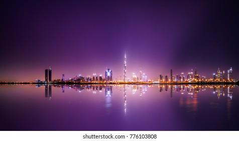 Colorful skyline panorama of Dubai with reflection UAE