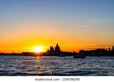 Colorful  skyline of Venice, Italy at sunset. Beautiful sunet behind Basilica Santa Maria della Salut.