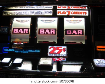 colorful slot machine paying off to show three bars which equals money