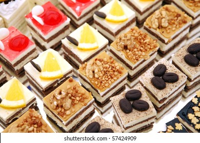 Colorful small fruity and chocolate dezerts - Shutterstock ID 57424909