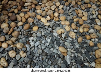 Colorful small pebbles or stones gravel texture or stone in garden with difference color.