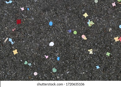 Colorful small pieces of paper on asphalt floor after a carnival in Baden, Switzerland March 2020. Symbols of joy, happiness, celebration, cheerfulness and festivals - Swiss traditions of spring.