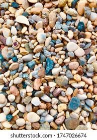 Colorful small stones sea pebbles background