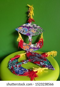 Colorful small 'Wau' or traditional kite in batik print cotton cloth for decoration.