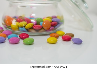 colorful Smarties candy in glass isolated on white background