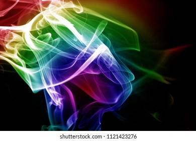 Colorful smoke in black bcakground / Smoke is a collection of airborne solid and liquid particulates and gases emitted when a material undergoes combustion or pyrolysis
