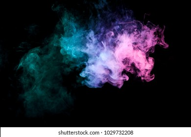 Colorful smoke of blue, pink, green on a black isolated background. Background from the smoke of vape