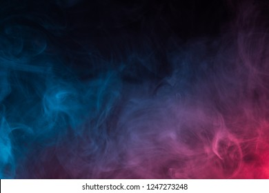Colorful smoke close-up on a black background