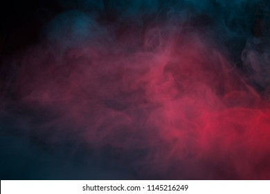 Colorful smoke on a black background closeup