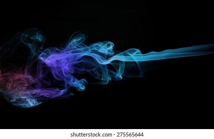 Colorful smoke on black background. studio shot