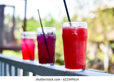 Colorful smoothie in glass with nature background