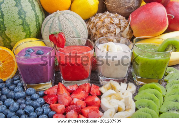 Colorful smoothies and fruits