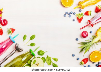 Colorful smoothies : green, pink, yellow and red with ingredients for Healthy eating , detox or diet food concept on White wooden background, Top view, frame