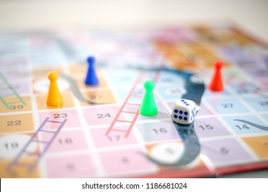 Colorful snakes and Ladders board Game.