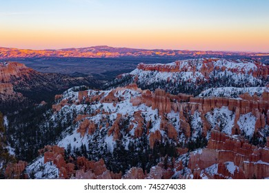 Colorful snowy Bryce Canyon National Park during sunset in Utah.