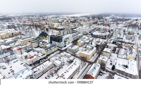 Colorful snowy roofs of houses of Lappeenranta city. Snow covered streets and roads. Finland, Europe. Aerial view