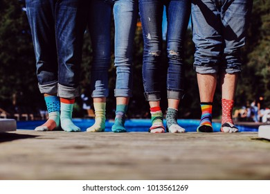 colorful socks with four friends at the pool