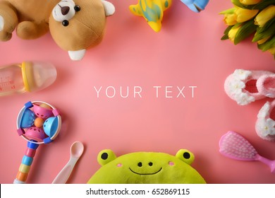 Colorful soft baby toys on pink background with copy space, Top view.