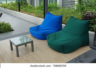 Colorful soft beanbag seats at the poolside