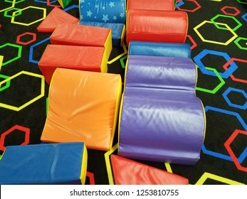 colorful soft foam blocks on black carpet
