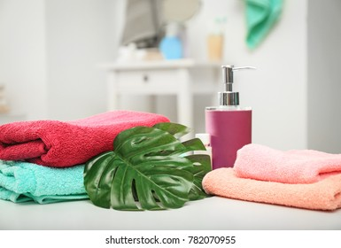 Colorful soft towels on table indoors