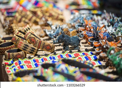 Colorful South African Bead Art in Bracelets, Rhino and Hippos in open air market