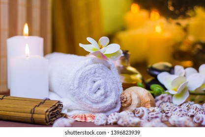 Colorful spa room image with seashell place for relaxation orchid flower and burning candles colorful spa massages center