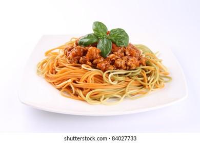 Colorful Spaghetti bolognese on a plate