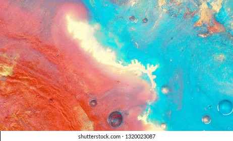 Colorful sparkling paints mix in beautiful patterns. Oil ink of coral, yellow, turqoise, orange and other colors spread on the surface and mix one into another creating amazing textures and design.