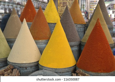Colorful spice cones in traditional shop or market