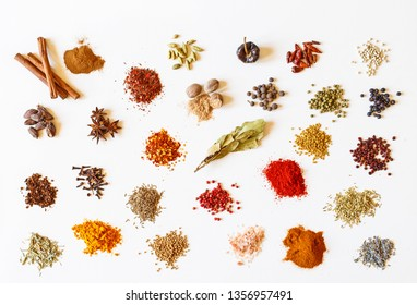 Colorful spices for cooking food on white background