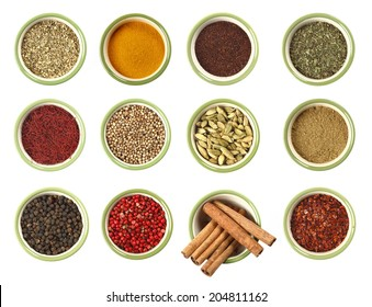 colorful spices in dish close up , top view, isolated on white background