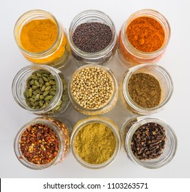 Colorful spices in glass jars